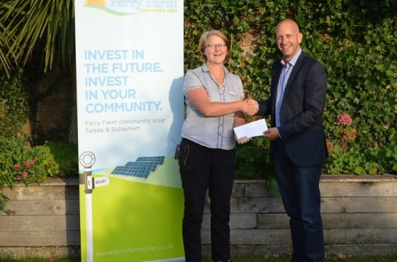 Ben Cooper, Director of Ferry Farm Community Solar, presenting grant award to Sue Osborne of SelseyWorks