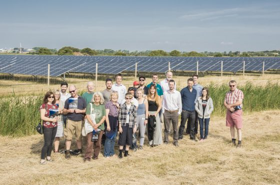 Local people and organisations standing in front of 36,000 panel Wick Community Solar Farm of Burnham and Weston Energy